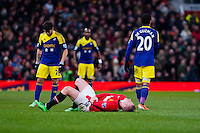 Sunday 05 January 2014<br /> Pictured:Curtis Obengis brought down by  Jonathan de Guzman<br /> Re: Manchester Utd FC v Swansea City FA cup third round match at Old Trafford, Manchester