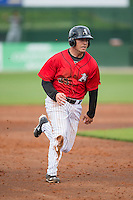 Nolan Earley (25) of the Kannapolis Intimidators hustles towards third base against the Hickory Crawdads at CMC-Northeast Stadium on April 17, 2015 in Kannapolis, North Carolina.  The Crawdads defeated the Intimidators 9-5 in game one of a double-header.  (Brian Westerholt/Four Seam Images)