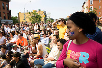Soccer fans watch the England versus United States match on 12 June 2010 on a large screen erected in the Prospect Heights neighborhood in Brooklyn, New York during the 2010 FIFA World Cup South Africa.