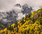San Juan Autumn #6.  The stormy weather was still very much in force when we arrived in Telluride, and it made for some very dramatic scenes in the rugged mountains towering above the town.<br /> <br /> Tech info:  Nikon D850 camera with Nikon 28-300mm lens at 150mm.  1/320 sec. at f11, ISO 250.<br /> <br /> Image ©2021 James D. Peterson
