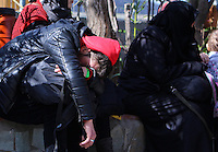 Pictured: An exhausted migrant at the road block Tuesday 23 February 2016<br /> Re: Migrants on their way back to Athens have been caught by the blocked off motorway at Tembi, where local farmers have closed off the road, protesting against pension and welfare reforms near Trikala, Greece.