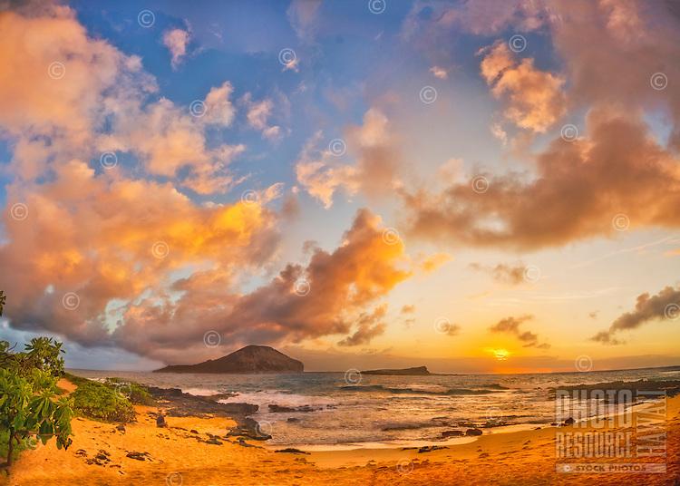 Sunrise over Rabbit and Bird Islands, seen from the beach at Makapu'u, O'ahu.