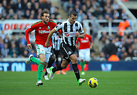 Saturday 17 November 2012<br /> Pictured: Steven Taylor of Newcastle  (R) closely followed by Michu of Swansea (L)<br /> Re: Barclay's Premier League, Newcastle United v Swansea City FC at St James' Park, Newcastle Upon Tyne, UK.