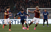 Calcio, Serie A: Roma vs Inter. Roma, stadio Olimpico, 19 marzo 2016.<br /> FC Inter's Danilo D'Ambrosio, center, is challenged by Stephan El Shaarawy, left, and Radja Nainggolan, during the Italian Serie A football match between Roma and FC Inter at Rome's Olympic stadium, 19 March 2016. The game ended 1-1.<br /> UPDATE IMAGES PRESS/Isabella Bonotto