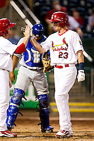 Ryan Jackson (23) of the Springfield Cardinals is congratulated by a teammate after hitting a home run during a game against the Tulsa Drillers at Hammons Field on July 18, 2011 in Springfield, Missouri. (David Welker / Four Seam Images)