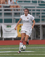 Boston Aztec defender Jessica Morrow (26) brings the ball forward.  In a Women's Premier Soccer League (WPSL) match, Boston Aztec (white) defeated Seacoast United Phantoms (blue), 3-0, at North Reading High School Stadium on Arthur J. Kenney Athletic Field on on June 25, 2013.