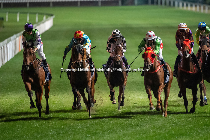Happy Valley, Hong Kong - December 4:Dream Warriors and Karis Teetan(Orange Cap) win the Longines International Jockey' Championship Handicap second leg at Happy Valley Racecourse in Hong Kong. Michael McInally/Eclipse Sportswire/CSM