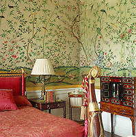 1830s Chinese wallpaper covers the walls of the Leicester Room against which is an inlaid cabinet