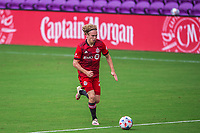 ORLANDO, FL - APRIL 24: Jacob Shaffelburg #24 of Toronto FC dribbles the ball during a game between Vancouver Whitecaps and Toronto FC at Exploria Stadium on April 24, 2021 in Orlando, Florida.