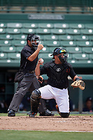 Umpire Chris Argueza calls a strike behind catcher Christopher Burgess during a Gulf Coast League game between the GCL Braves and GCL Orioles on August 5, 2019 at Ed Smith Stadium in Sarasota, Florida.  (Mike Janes/Four Seam Images)