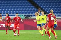 YOKOHAMA, JAPAN - AUGUST 6: Jessie Fleming #17 of Canada goes forward against Stina Blackstenius #11 of Sweden during a game between Canada and Sweden at International Stadium Yokohama on August 6, 2021 in Yokohama, Japan.