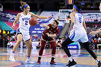 GREENSBORO, NC - MARCH 06: Makayla Dickens #10 of Boston College passes the ball between Haley Gorecki #2 and Leaonna Odom #5 of Duke University during a game between Boston College and Duke at Greensboro Coliseum on March 06, 2020 in Greensboro, North Carolina.