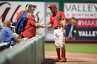 Philadelphia Phillies shortstop J.P. Crawford (12) signs autographs on his way to the clubhouse during a game against the Florida Fire Frogs while on rehab assignment with the Clearwater Threshers on June 1, 2018 at Spectrum Field in Clearwater, Florida.  Florida defeated Clearwater 12-10.  (Mike Janes/Four Seam Images)