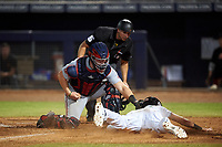Surprise Saguaros catcher Jakson Reetz (4) applies the tag to C.J. Chatham (24) with home plate umpire Paul Clemons in position to make the call during an Arizona Fall League game against the Peoria Javelinas on September 22, 2019 at Peoria Sports Complex in Peoria, Arizona. Surprise defeated Peoria 2-1. (Zachary Lucy/Four Seam Images)