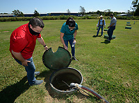 Chris Clark (from left), financial analyst for Springdale Water Utilities, and Kim Patulak, human resources director for the city of Springdale, check out equipment Friday, Aug. 21, 2020, alongside Heath Ward, executive director of Springdale Water Utilities, and Al Drinkwater, a volunteer environmental quality consultant, as the four inspect the former Bethel Heights wastewater treatment facility. The Benton County Election Commission certified that the results of an Aug. 11 election to annex Bethel Heights into Springdale. Visit nwaonline.com/200823Daily/ for today's photo gallery.<br /> (NWA Democrat-Gazette/Andy Shupe)
