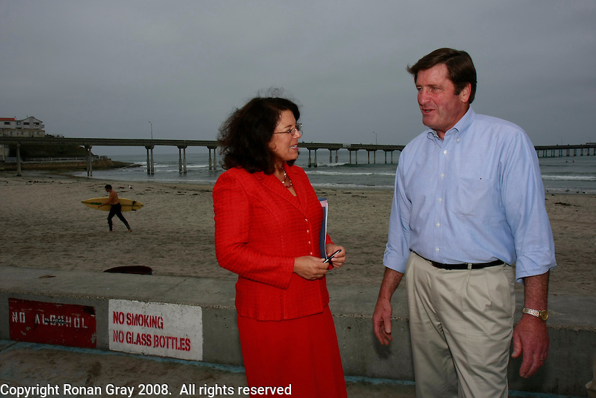 Lieutenant Governor John Garamendi and Assembly Member Lori Saldaña look at samples of plastic pellets that are a common form of marine debris  found in California waters, Ocean Beach, July 25, 2008.  The two were in Ocean Beach to speak about a new report on California Marine Debris and laws to clean-up and protect California?s beaches, marine life and ocean from trash.