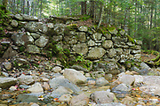 Old bridge abutment at the Redrock Brook crossing along the Franconia Branch (today's Franconia Brook Trail) of the old East Branch & Lincoln Railroad (1893-1948) in the Pemigewasset Wilderness of New Hampshire. Tropical Storm Irene damaged this abutment in 2011, and it no longer looks this way.
