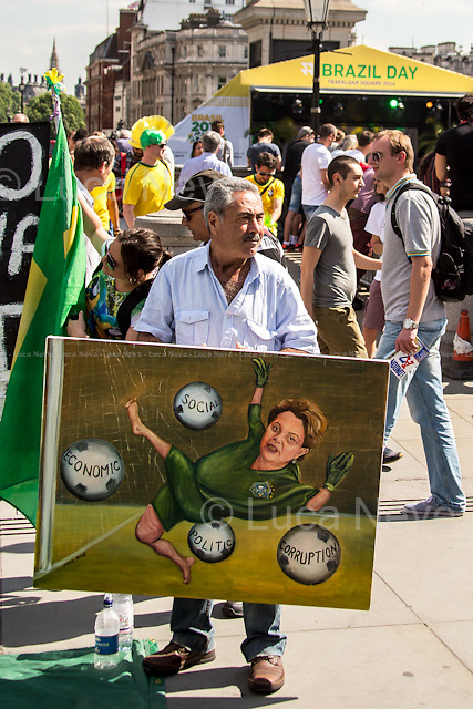 """Kaya Mar (Painter and political caricaturist).<br /> <br /> London, 12/06/2014. Today, on the day of the opening ceremony of the 20th World Cup of Football in Sao Paolo (Brasil), a group of Brasilian people held a demonstration in Trafalgar Square to raise awareness of the problems that are still affecting their country (see photo captions) and in support and solidarity with the protests currently happening in Brasil. Meanwhile, the official """"Brazil Day"""" organised by the Mayor of London was held without disruption in the main square."""