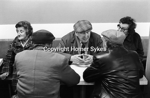 Whitechapel, London. 1974.<br /> In a café in Whitchapel High Street, a group of friends discuss life.
