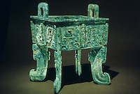 "China:  Rectangular Cauldron (fang ding),  Shang dynasty, 13th - 11th C. B.C.  16 1/8""  bronze.  Institute of Archaeology, Beijing.  Great Bronze Age of China, exhibition."