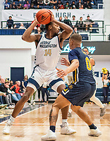 WASHINGTON, DC - FEBRUARY 22: Maceo Jack #14 of George Washington pulls the ball back from Ayinde Hikim #0 of La Salle during a game between La Salle and George Washington at Charles E Smith Center on February 22, 2020 in Washington, DC.
