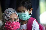 15 August  2019, Tangerang Jakarta ,Indonesia : Veronica (one name only) with her six year old daughter Misha who suffers severe asthma attacks. Veronica has joined a court case against the Government to improve air quality in Jakarta .Air pollution is a major issue in Jakarta, consistently ranked one of the most polluted cities in the world. Health affected citizens have launched a legal challenge against the city government in a bid to force the Jakarta Governor to address the problem immediately. Picture by Graham Crouch/The Telegraph