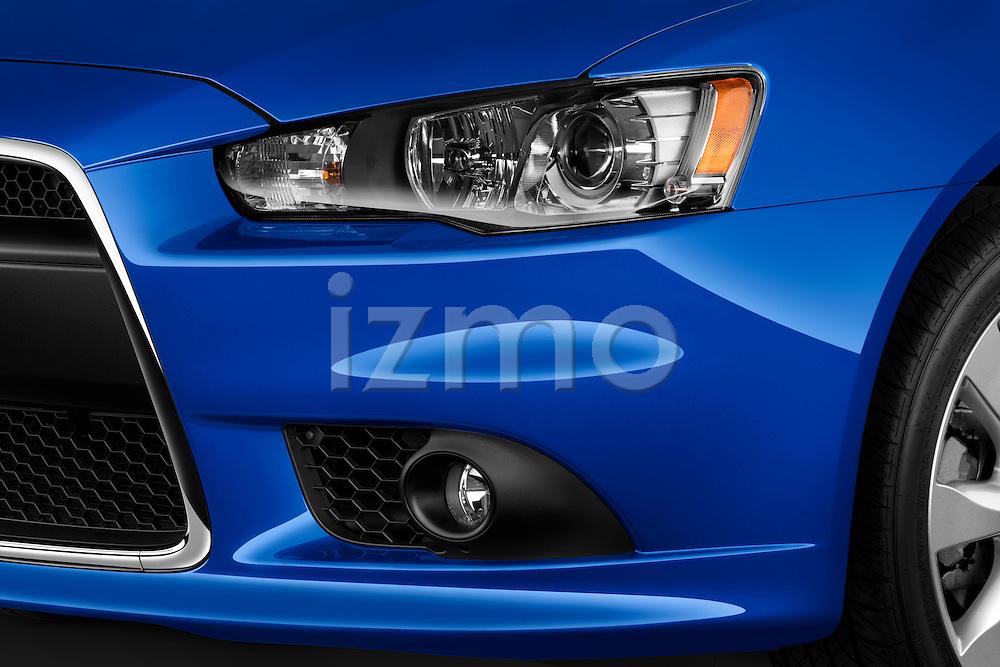 Front headlight detail on a 2012 Mitsubishi Lancer Sportback GT