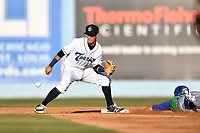 Asheville Tourists shortstop Jose Gomez (4) fields the ball and prepares to tag out a hard sliding John Brontsema (15) during a game against the Lexington Legends  at McCormick Field on May 31, 2017 in Asheville, North Carolina. The Tourists defeated the Legends 12-5. (Tony Farlow/Four Seam Images)