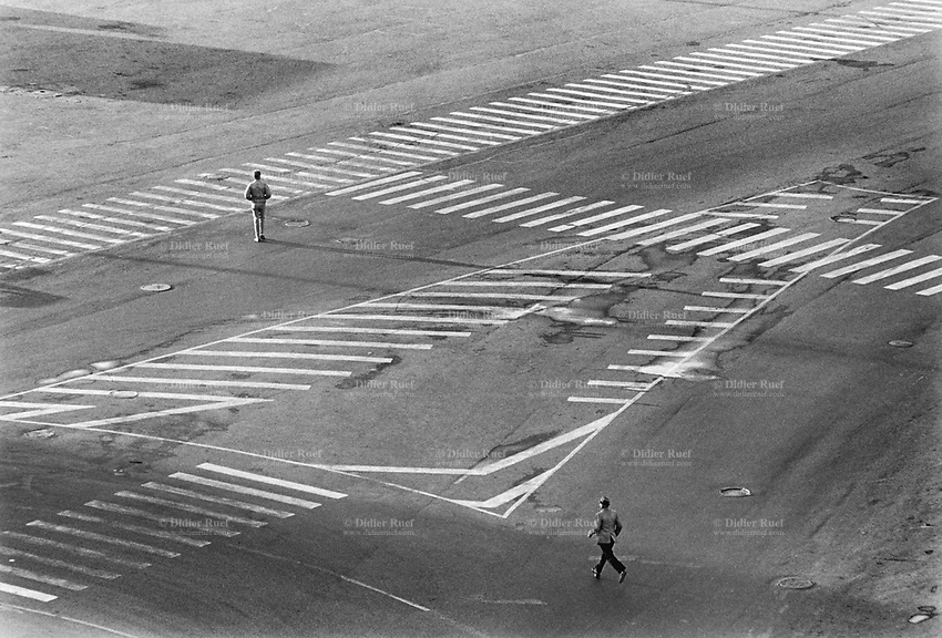 Russia. Krasnodar Krai Region. Krasnodar. City center. Two men walk on the asphalt road. Various pedestrian crossings. Krasnodar (also known as Kuban) is the largest city and the administrative centre of Krasnodar Krai in Southern Russia. 19.09.1993 © 1993 Didier Ruef