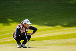 Ha-Na Jang of Korea lines up a putt during the Hyundai China Ladies Open 2014 at World Cup Course in Mission Hills Shenzhen on December 14 2014, in Shenzhen, China. Photo by Xaume Olleros / Power Sport Images