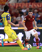 Calcio, Serie A: Roma vs ChievoVerona. Roma, stadio Olimpico, 18 ottobre 2014.<br /> Roma's Alessandro Florenzi is challenged by Chievo Verona's Ervin Zukanovic, left, during the Italian Serie A football match between Roma and ChievoVerona at Rome's Olympic stadium, 18 October 2014.<br /> UPDATE IMAGES PRESS/Isabella Bonotto