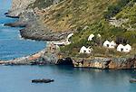 Italy, Calabria, Praia a Mare: popular resort at Riviera dei Cedri, huts at island Isola di Dino