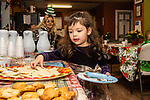 TORRINGTON, CT. 20 December 2019-122019BS13 - Amaya Morann, 3, of Winsted reaches for a Christmas cookie, during a visit by Santa at the FISH of Northwestern Connecticut Homeless Shelter in Torrington on Friday. Bill Shettle Republican-American