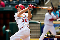 Kyle Conley (35) of the Springfield Cardinals follows through his swing during a game against the Arkansas Travelers at Hammons Field on May 8, 2012 in Springfield, Missouri. (David Welker/ Four Seam Images)