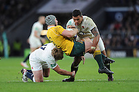 David Pocock of Australia is upended by Joe Marler and Nathan Hughes of England during the Old Mutual Wealth Series match between England and Australia at Twickenham Stadium on Saturday 3rd December 2016 (Photo by Rob Munro)