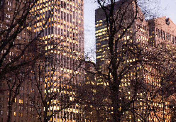 Defocused View of Buildings on Fifth Avenue near Grand Army Plaza from Central Park at Dusk, Midtown Manhattan, New York City, New York State, USA