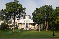 The Athenaeum Hotel, a large wooden hotel and one of the signature landmarks of the Chautauqua Institution opened in 1881. Chautauqua Institution, NY. June 22, 2014. Photo by Brendan Bannon