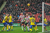 Leeds United's midfielder Ezgian Alioski (10) heads clear at the back post during the Sky Bet Championship match between Sheff United and Leeds United at Bramall Lane, Sheffield, England on 1 December 2018. Photo by Stephen Buckley / PRiME Media Images.