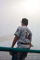 Tri-City ValleyCats Miguel Figueroa (24) outside the dugout in a fog delay during a NY-Penn League game against the Brooklyn Cyclones on August 17, 2019 at MCU Park in Brooklyn, New York.  Brooklyn defeated Tri-City 2-1.  (Mike Janes/Four Seam Images)