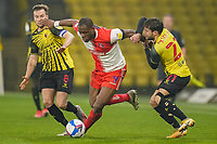 Tom Cleverley of Watford, Uche Ikpeazu of Wycombe Wanderers (centre) and Kiko Femenía of Watford during the Sky Bet Championship behind closed doors match between Watford and Wycombe Wanderers at Vicarage Road, Watford, England on 3 March 2021. Photo by David Horn.
