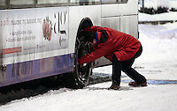 Pictured: A bus driver fits snow chains to his vehicle in Larissa, central Greece Thursday 12 January 2017<br /> Re: Heavy snow has affected most parts of Greece.
