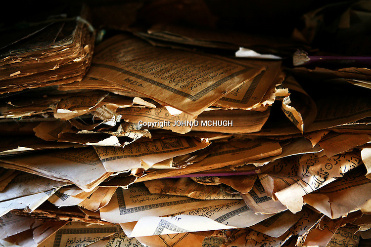 Pages from old Korans are preserved in a mosque in Klaimendo village in North Darfur, 04 Dec, 2008. Despite the fact that North Darfur is believed to currently have the highest concentration of NGOs in the world, the creation of Klaimendo district and village is the work of people born and raised in the area, rather than an outside aid agency. (John D McHugh)