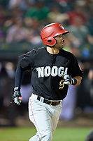 Chattanooga Lookouts second baseman Levi Michael (9) runs to first base during a game against the Jackson Generals on April 29, 2017 at The Ballpark at Jackson in Jackson, Tennessee.  Jackson defeated Chattanooga 7-4.  (Mike Janes/Four Seam Images)