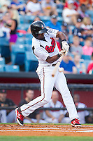 Eugenio Velez (4) of the Nashville Sounds makes contact with the baseball during the game against the Oklahoma City RedHawks at Greer Stadium on July 25, 2014 in Nashville, Tennessee.  The Sounds defeated the RedHawks 2-0.  (Brian Westerholt/Four Seam Images)