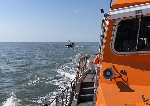 Arklow RNLI's all-weather lifeboat takes a stricken fishing vessel under tow on Friday 14 May