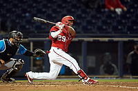 Washington Nationals Yadiel Hernandez (29) bats during a Major League Spring Training game against the Miami Marlins on March 20, 2021 at FITTEAM Ballpark of the Palm Beaches in Palm Beach, Florida.  (Mike Janes/Four Seam Images)
