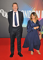 """Steven Knight and guest at the 65th BFI London Film Festival """"Spencer"""" Headline gala, Royal Festival Hall, Belvedere Road, on Thursday 07th October 2021, in London, England, UK. <br /> CAP/CAN<br /> ©CAN/Capital Pictures"""