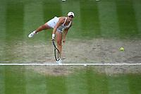 8th July 2021, Wimbledon, SW London, England; 2021 Wimbledon Championships, quarterfinals; Ashleigh Barty (Aus) serves to Angelique Kerber (Ger)