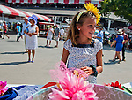 Molly O'Neill, 8, tried on some hats and fascinators at Saratoga Race Course on Travers Stakes Day in Saratoga Springs, New York on August 25, 2012.