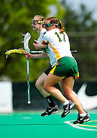 1 May 2010: University of Vermont Catamount attacker Kaitlyn Fuller, a Senior from Jordan, NY, celebrates a goal with Alison Haigh against the University of New Hampshire Wildcats at Moulton Winder Field in Burlington, Vermont. The Lady Catamounts fell to the visiting Wildcats 18-10 in the last game of the 2010 regular season. Mandatory Photo Credit: Ed Wolfstein Photo
